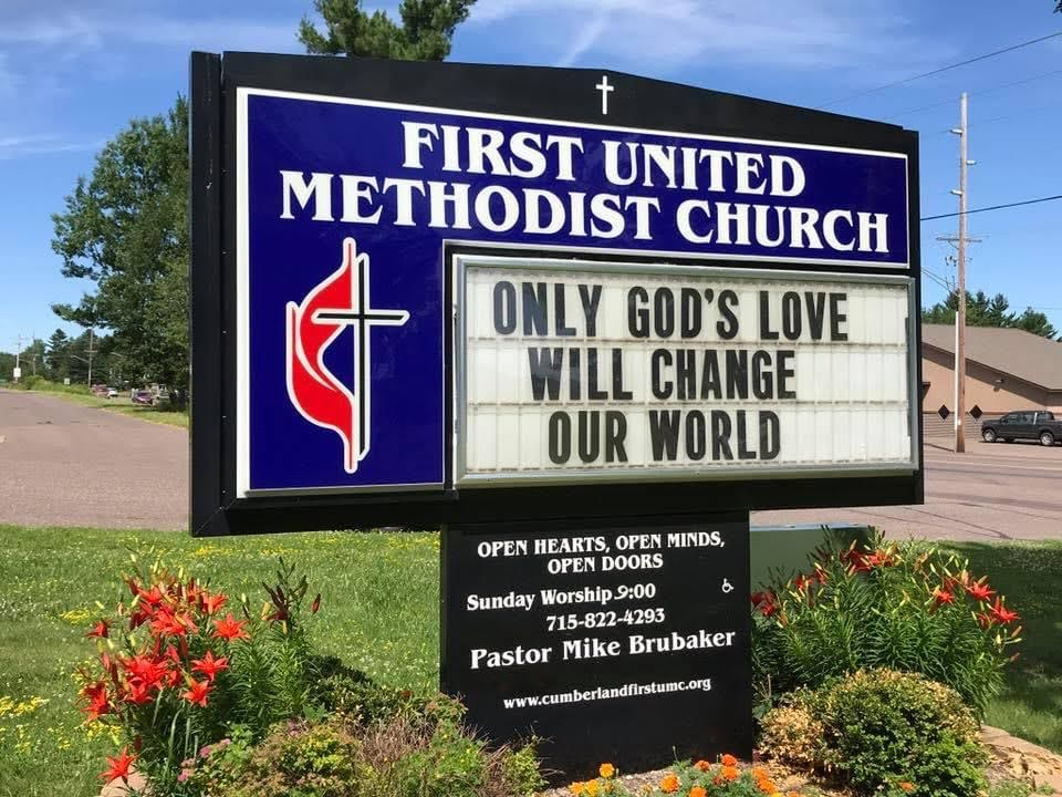 Only God's love will change our world. Sign at First United Methodist Church.